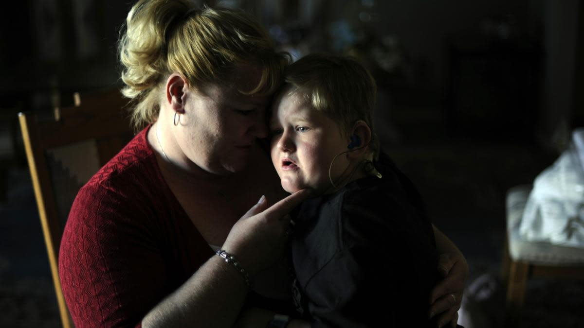 Shannon Zimmerman and her son Logan who has autism, in their home in Westminster, Colorado, 2012. (Credit: Hyoung Chang/The Denver Post via Getty Images)