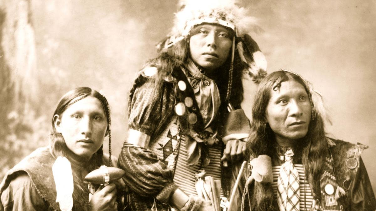 Three young Native American men, probably Sioux, wearing native accessories, 1899. (Photo by Heyn/Buyenlarge/Getty Images)