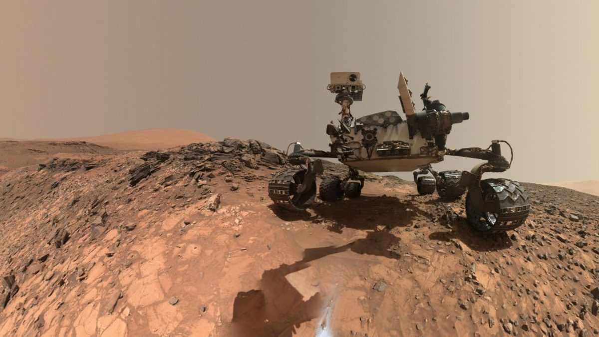 "NASA's Curiosity Mars rover shown at the site from which it reached down to drill into a rock target called ""Buckskin"" on lower Mount Sharp. (Credit: NASA)"