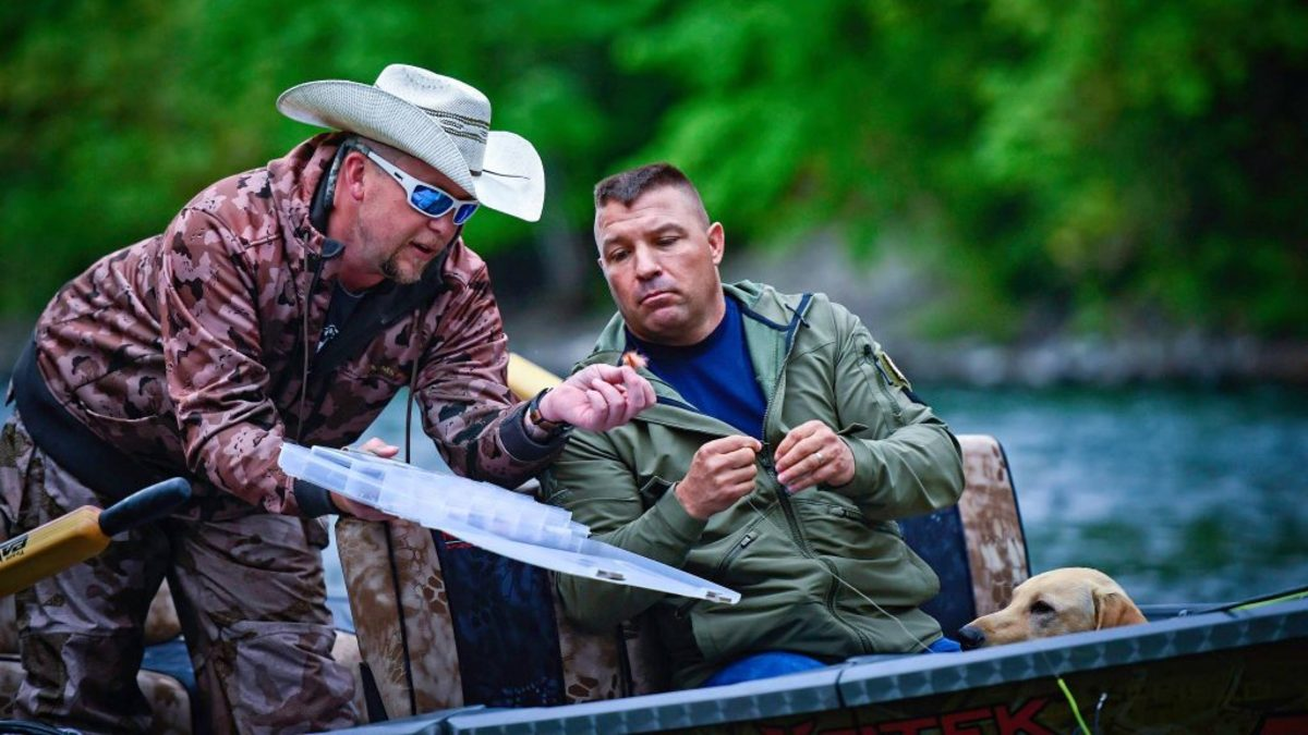 Brett Miller guided wounded Desert Storm/Iraqi Freedom veteran Michael Pence of Eugene on the McKenzie River. (Courtesy of Warfighter Outfitters Inc.)