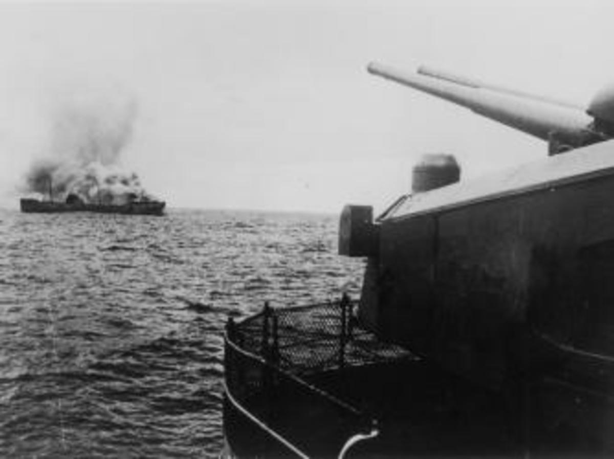 A view of the German battleship Bismarck firing on a merchant ship in the north Atlantic.  (Credit: Keystone/Getty Images)
