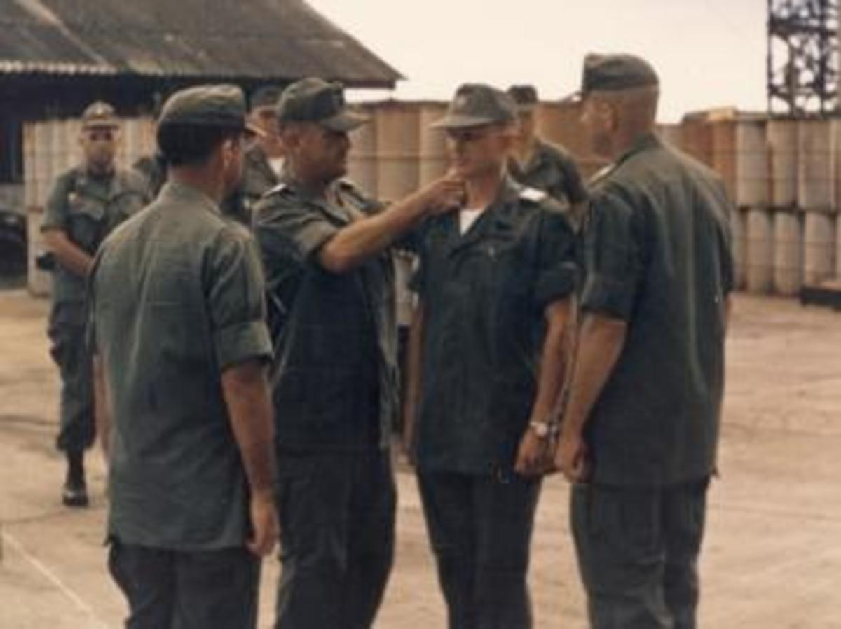 U.S. Army Maj. Charles Kettles in his second tour of duty in Vietnam, at a change of command ceremony where he took charge of the 121st Assault Helicopter Company, Soc Trang, Vietnam, 1969.  (Credit: Retired U.S. Army Lt. Col. Charles Kettles)