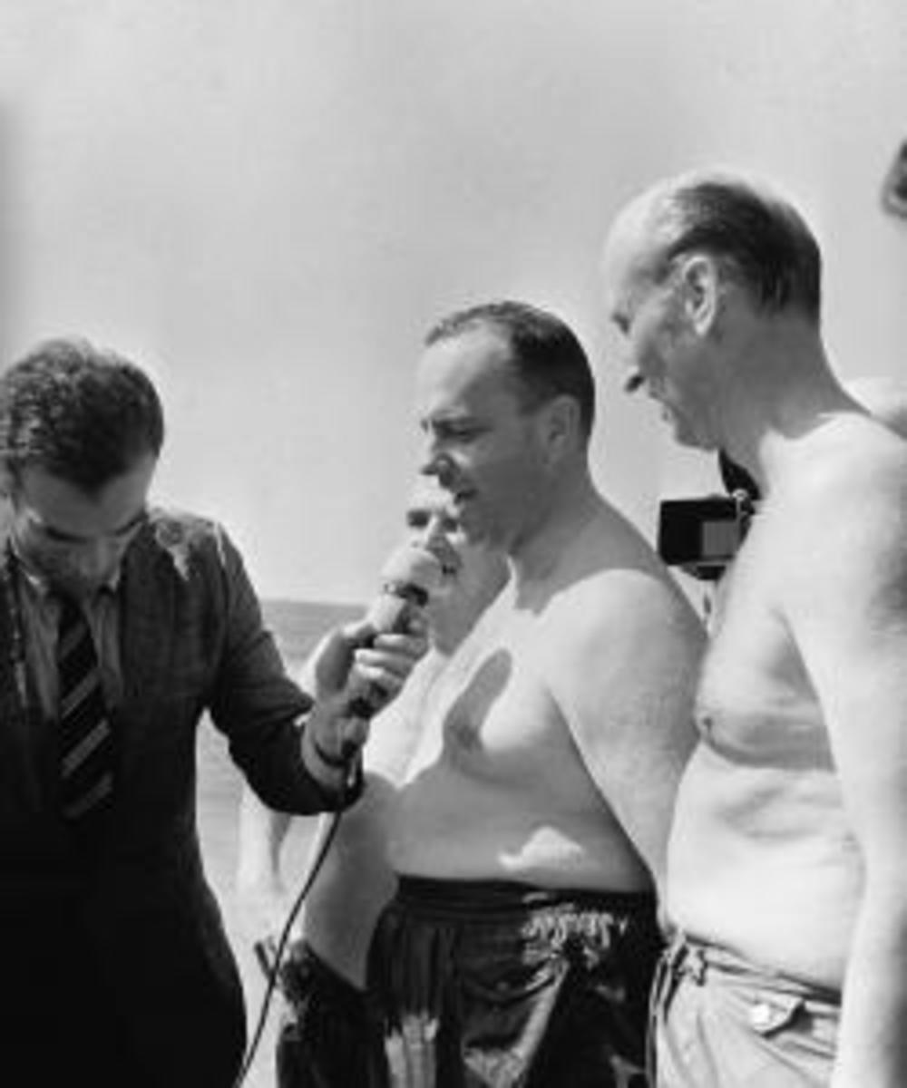 US Ambassador Duke (pictured on right) meets with reporters after staging a swimming photo-op in Palomares. (Credit: Gianni Ferrari/Cover/Getty Images)