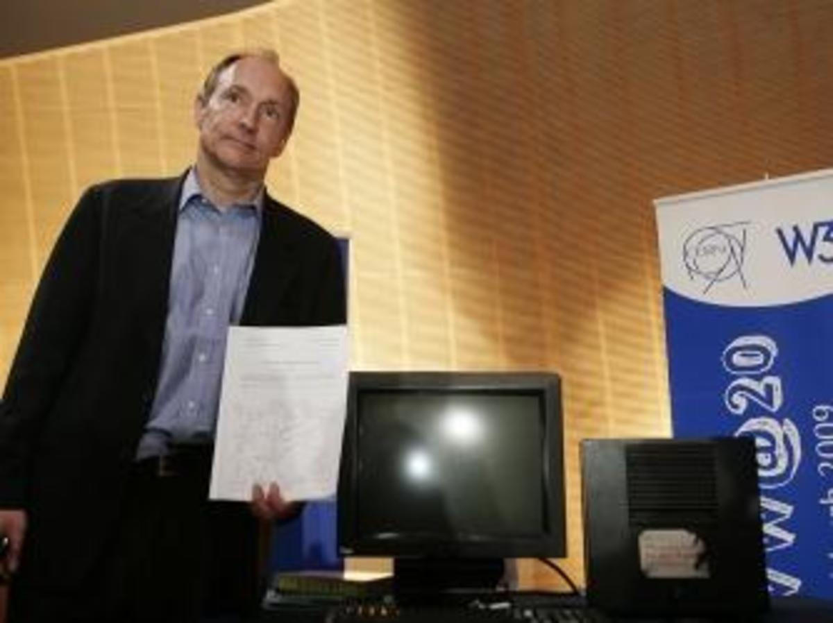 Tim Berners-Lee, Inventor of the Web, poses in front of the first World Wide Web Server. (Credit: SEBASTIAN DERUNGS/AFP/Getty Images)
