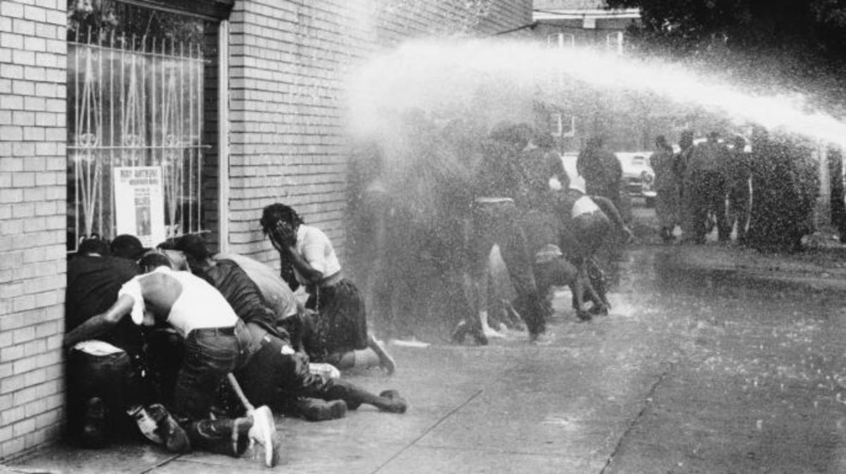 "Protestors of the ""Children's Crusade"" being attacked by dogs and water cannons. (Credit: Michael Ochs Archives/Getty Images)"