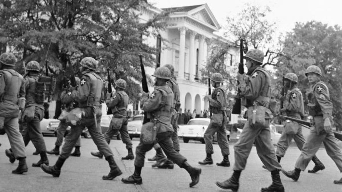 Army troops patrol past the famed courthouse square in downtown Oxford, Mississippi in the wake of student riots on the campus of Ole Miss. (Credit: AP Photo)