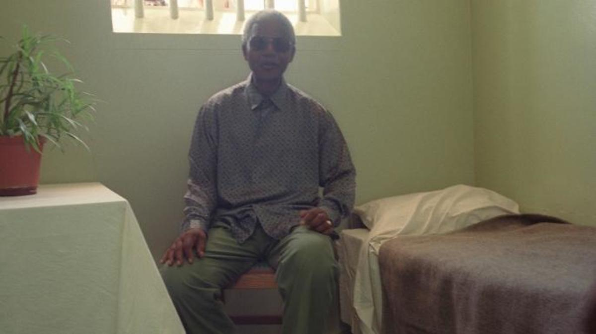 Nelson Mandela visits his former prison cell on Robben Island in February 1995.