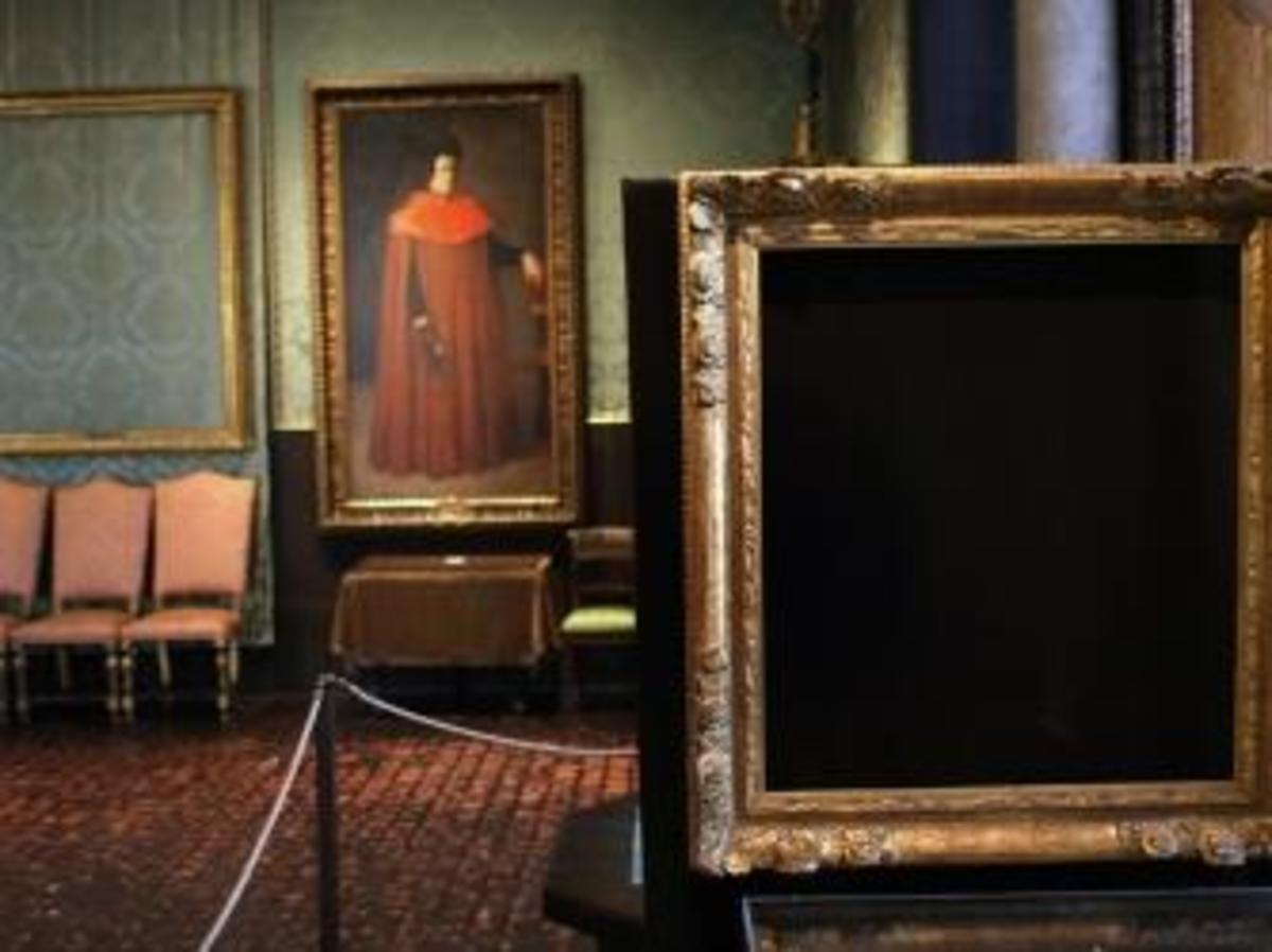 "An empty frame on the right is where Vermeer's ""The Concert"" once was. (Credit: David L. Ryan/The Boston Globe via Getty Images)"