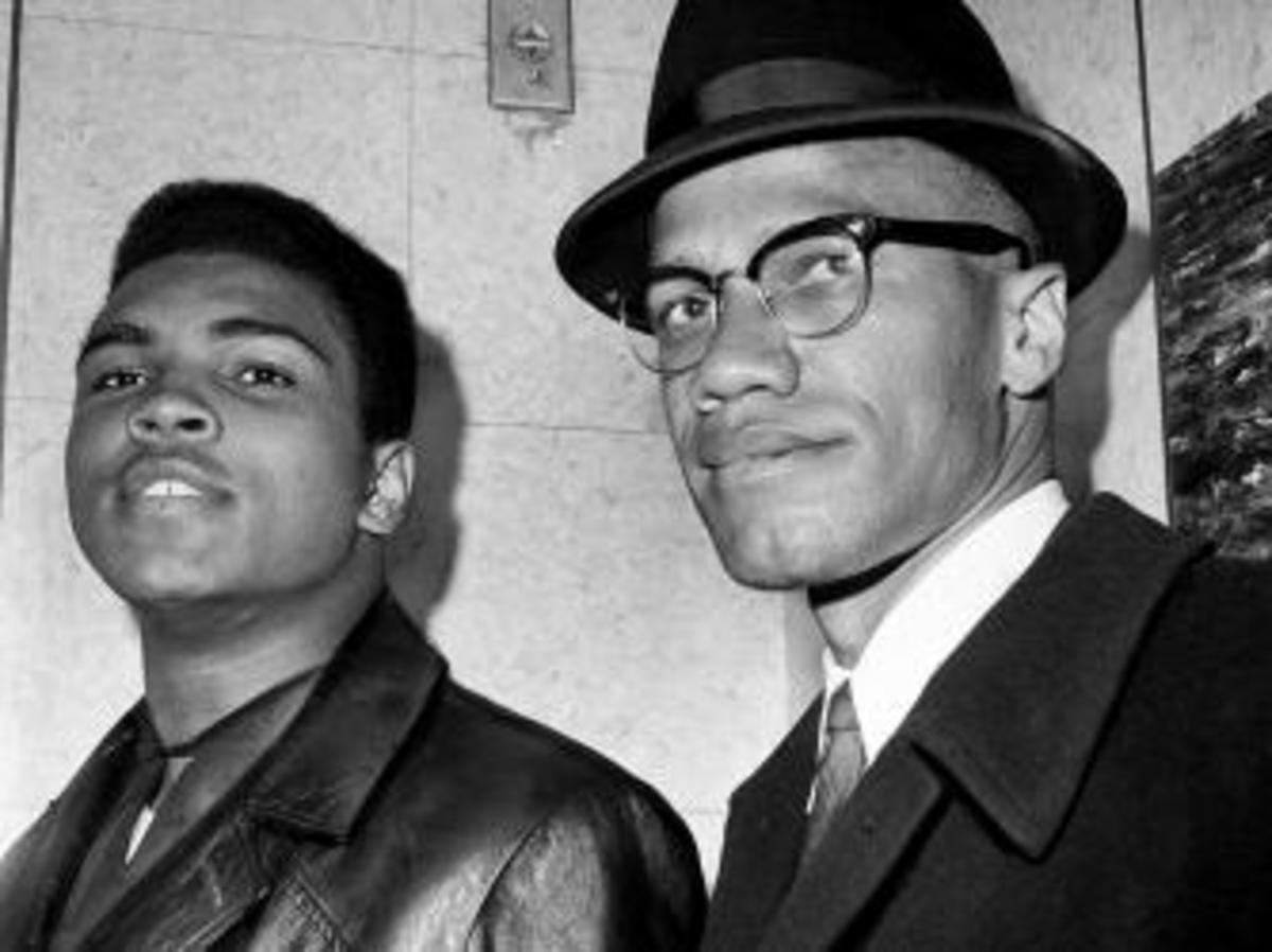 Malcolm X with Muhammad Ali, 1964. (Credit: John Peodincuk/NY Daily News Archive via Getty Images)
