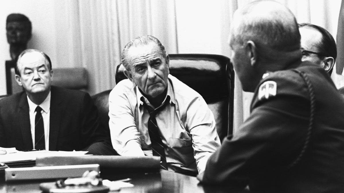President Lyndon B. Johnson meeting with General Creighton Abrams to discuss the partial halt to bombings in North Vietnam in March, 1968. (Credit: Corbis/Getty Images)