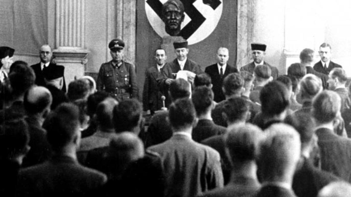 Roland Freisler, the President of the 'National Socialist People's Court' (Volksgerichtshof). Here he is reading out the verdict against the eight suspects of the assassination attempt on Hitler, the so-called July Plot, at the court in Berlin, 1944. (Credit: DPA/Picture-Alliance/AP Images)