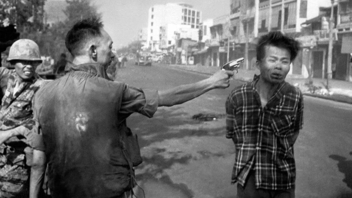 South Vietnamese Gen. Nguyen Ngoc Loan, chief of the national police, fires his pistol, shoots, executes into the head of suspected Viet Cong officer Nguyen Van Lem (also known as Bay Lop) on a Saigon street Feb. 1, 1968, early in the Tet Offensive. (Credit: Eddie Adams/AP Photo)