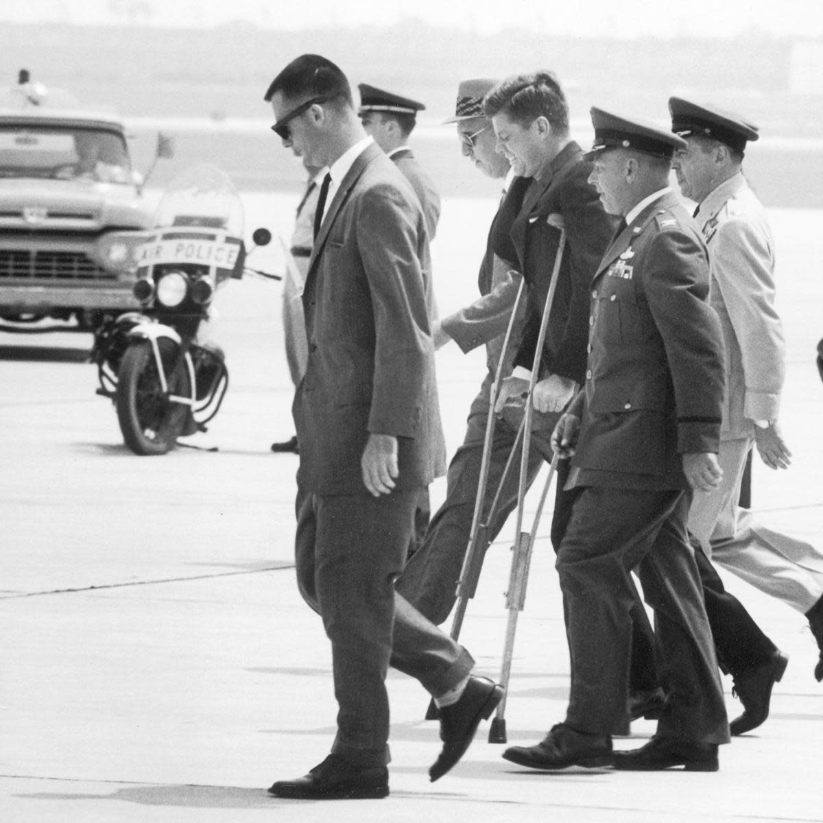 President John F. Kennedy on crutches due to back ailment. (Credit: Ed Clark/The LIFE Picture Collection/Getty Images)
