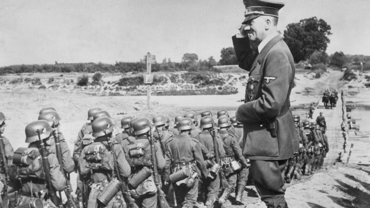 Adolf Hitler overseeing his military troop during the Nazi occupation of Poland, 1939. (Credit: Hulton Archive/Getty Images)