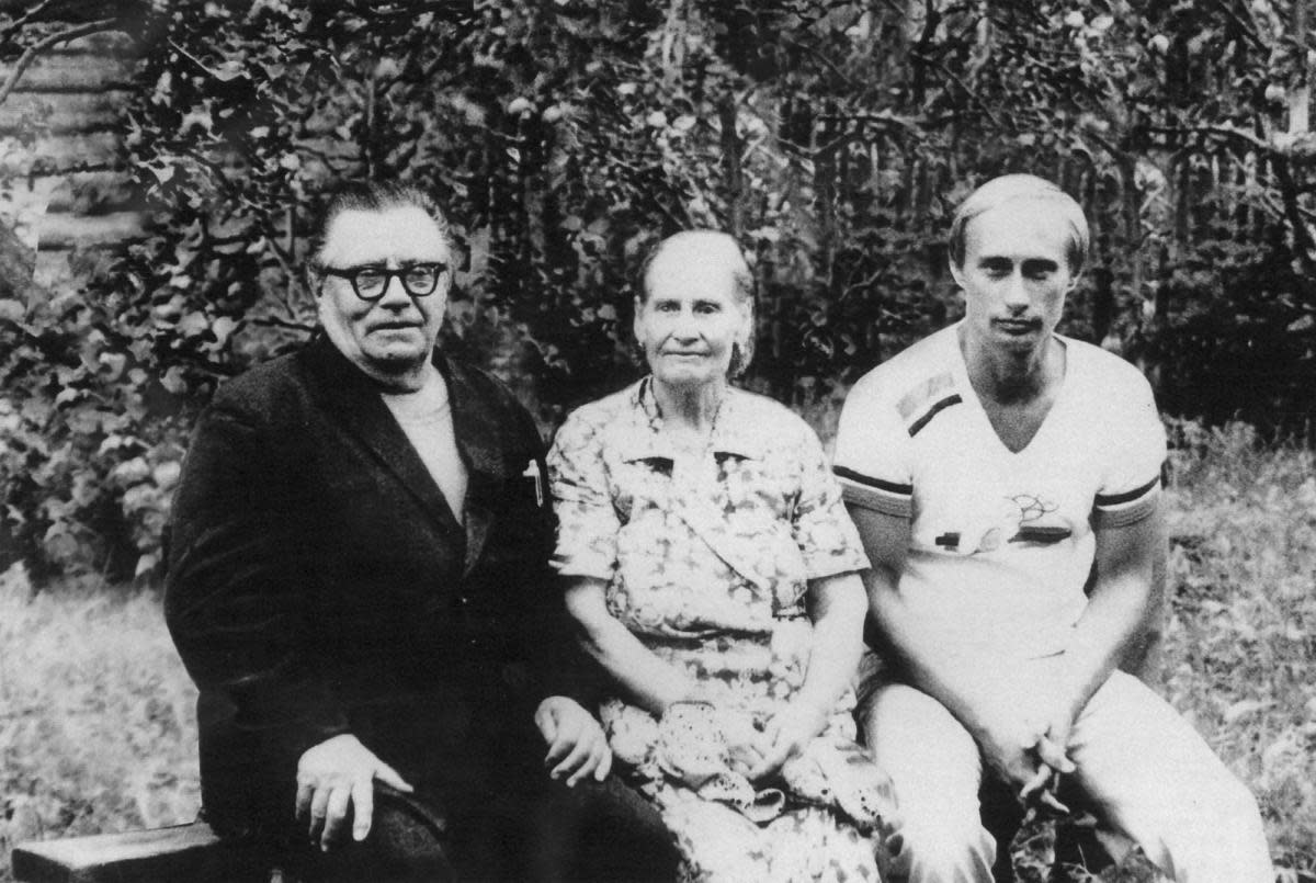 Vladimir Putin, right, with his parents Maria and Vladimir Putin in 1985, just before his departure to Germany, where he worked as a KGB officer. (Credit: Laski Diffusion/Newsmakers/Getty Images)