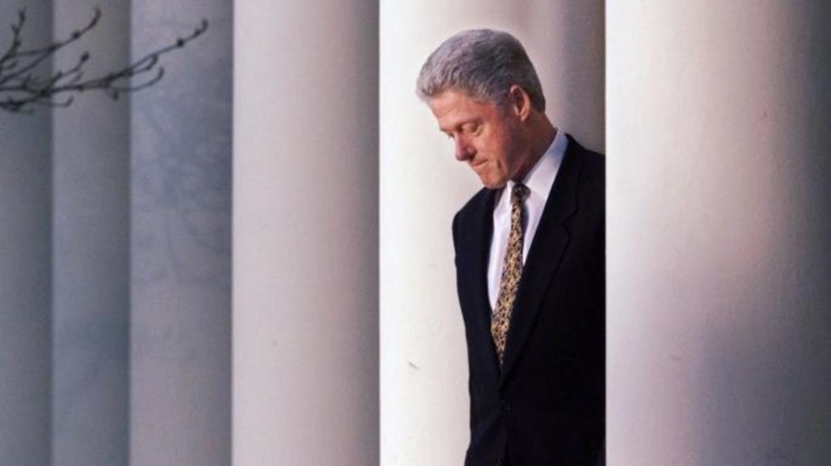 President Clinton walking to the podium to deliver a short statement on the impeachment inquiry, apologizing to the country for his conduct in the Monica Lewinsky affair and that he would accept a congressional censure or rebuke. (Credit: J. Scott Applewhite/AP Photo)