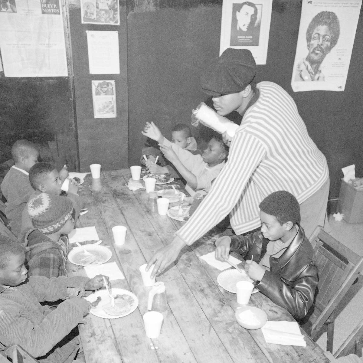 Brad Jones, member of the Philadelphia Black Panthers Organization, helping serve breakfast to youngsters. (Credit: Bill Ingraham/AP Photo)