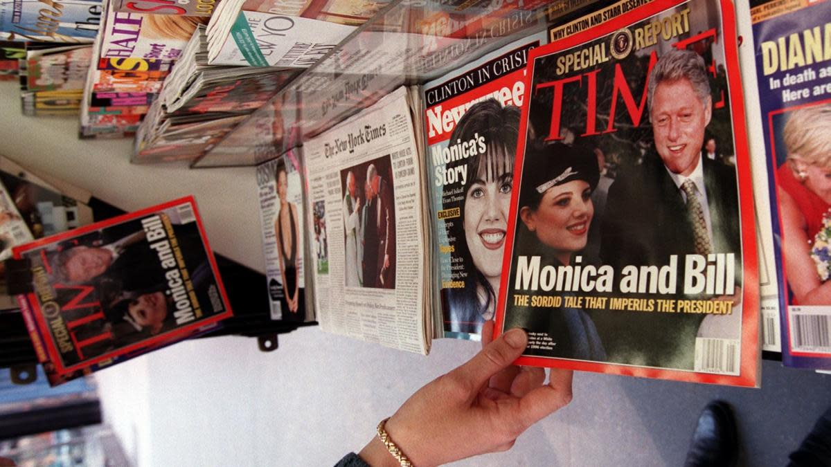 A news stand filled with magazine issues regarding the Monica Lewinsky scandal. (Credit: Jon Levy/AFP/Getty Images)