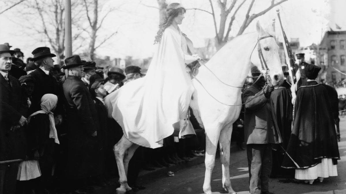 Inez Milholland, wearing a white cape while seated on white horse, at the National American Woman Suffrage Association parade, March 3, 1913. (Credit: F A Archive/REX/Shutterstock)