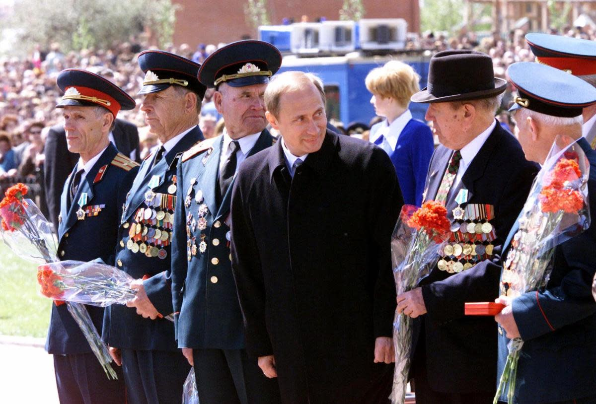 Vladimir Putin with World War II veterans in May 2000. They are gathered in Kursk, Russia, site of history's biggest tank battle, when Soviet forces defeated a major Nazi German offensive in 1943. Putin invoked WWII victories as a way to restore Russian pride after the Soviet collapse.