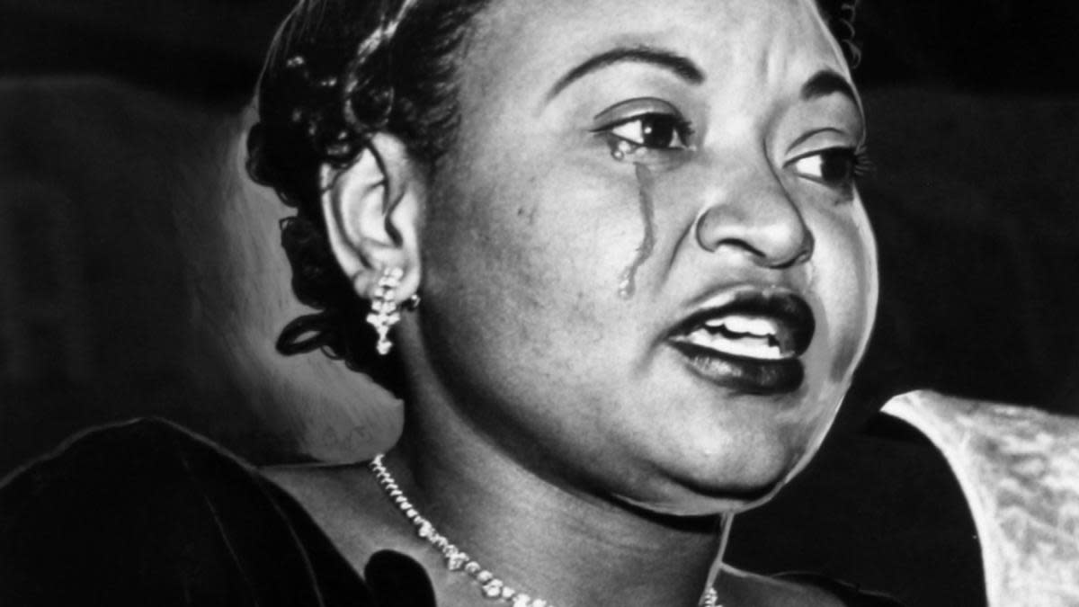Mamie Bradley, mother of lynched teenager Emmett Till, crying as she recounts her son's death, 1955. (Credit: Afro American Newspapers/Gado/Getty Images)