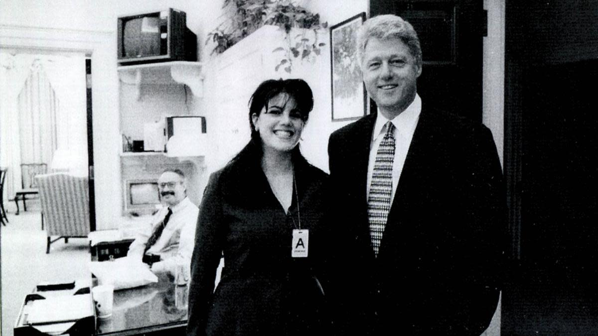 A photograph showing former White House intern Monica Lewinsky with President Bill Clinton at a White House function submitted as evidence. (Credit: Getty Images)