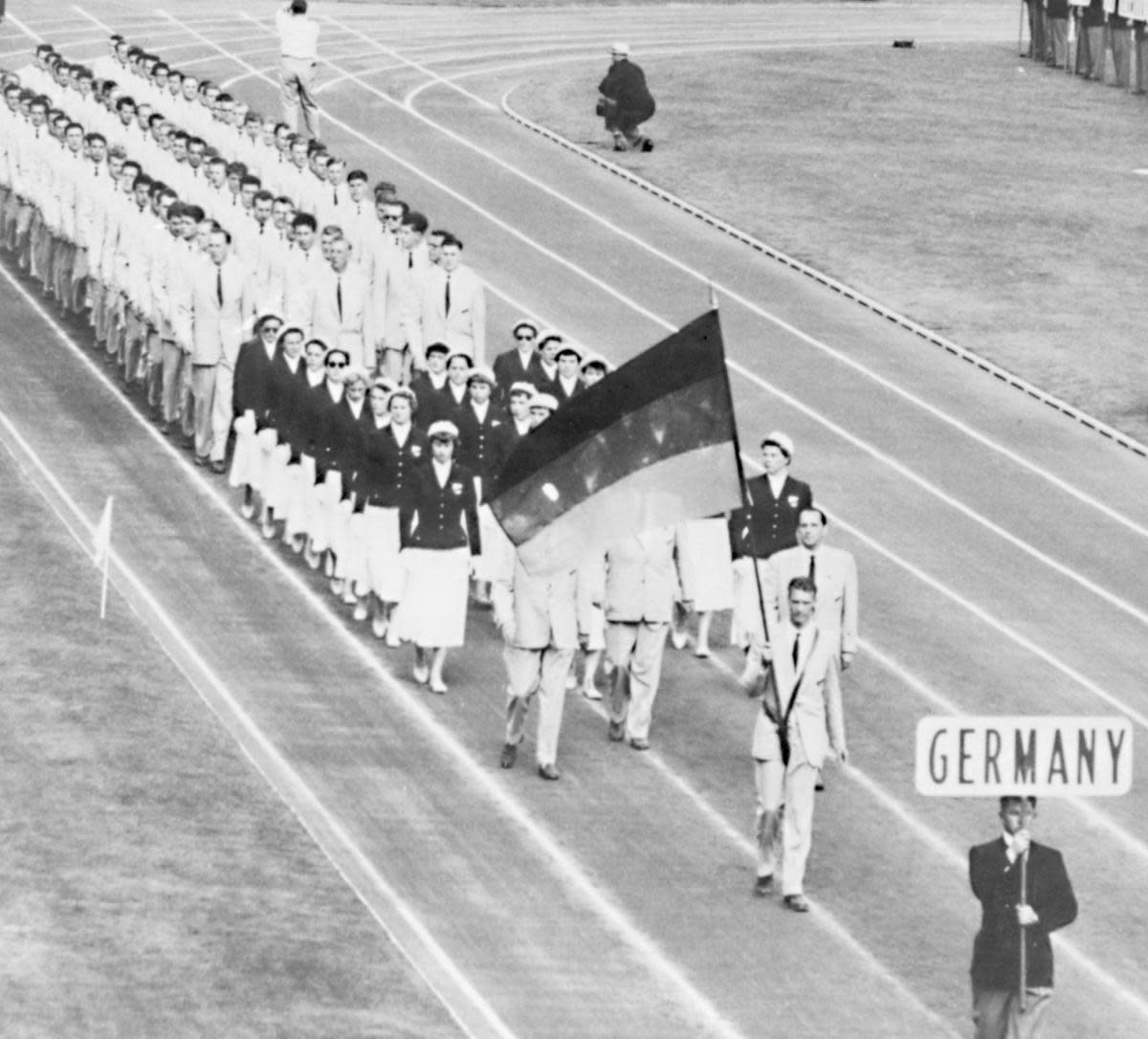 Opening of the 1956 Summer Olympics in Melbourne. (Credit: Ullstein Bild/Getty Images)