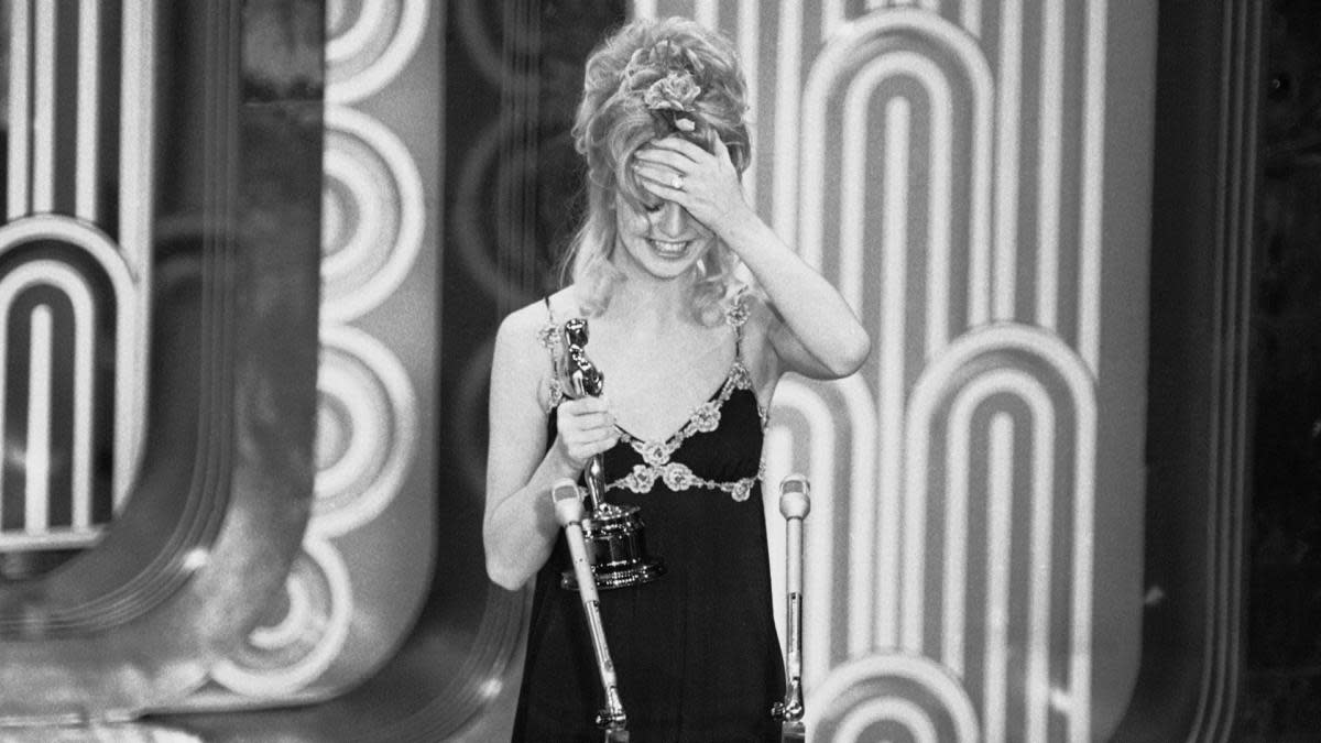 "Actress Goldie Hawn after announcing that George C. Scott had won the Academy Award for best actor for his role in ""Patton"". Scott said he would send the Oscar back if it was sent to him. (Credit: AP Photo)"