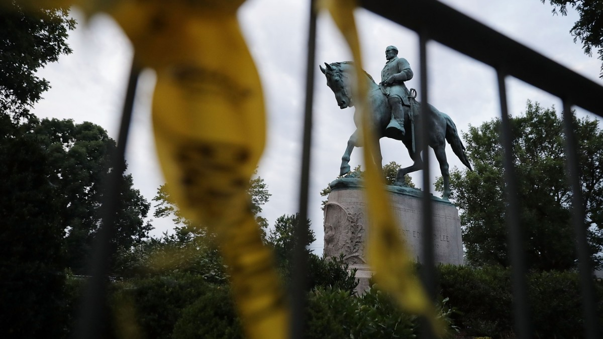 The statue of Confederate General Robert E. Lee in the center of Emancipation Park the day after the Unite the Right rally devolved into violence August 13, 2017 in Charlottesville, Virginia. The Charlottesville City Council voted to remove the statue and change the name of the space from Lee Park to Emancipation Park, sparking protests from white nationalists, neo-Nazis, the Ku Klux Klan and members of the 'alt-right.'  (Credit: Chip Somodevilla/Getty Images)