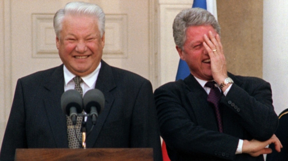 U.S. President Bill Clinton breaking into laughter after Russian President Boris Yeltsin made a comment about journalists at a news conference in Hyde Park, New York on October 23, 1995.