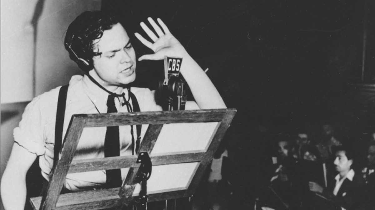 Orson Welles rehearsing his radio depiction of H.G. Wells' classic, The War of the Worlds. The broadcast, which claimed that aliens from Mars had invaded New Jersey, terrified thousands of Americans.