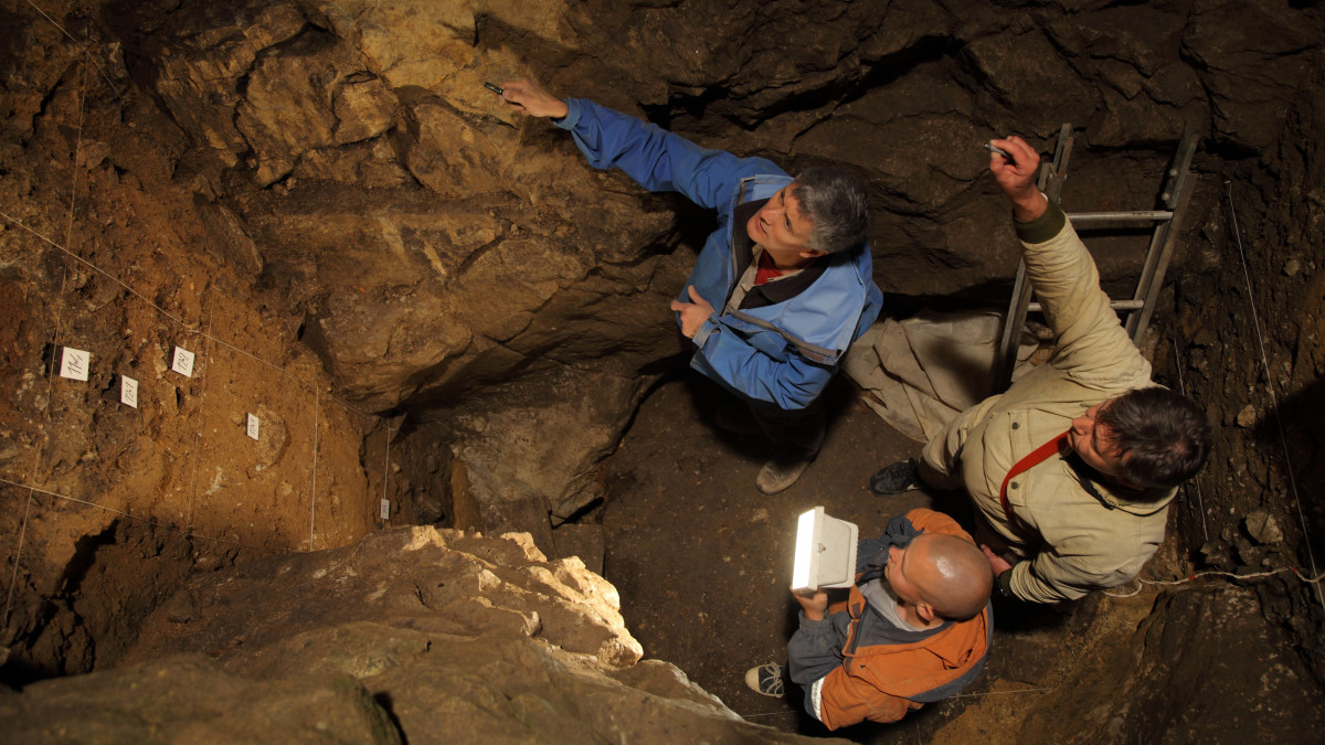 Richard (Bert) Roberts, Vladimir Ulianov and Maxim Kozlikin (clockwise from top) in the East Chamber of Denisova Cave, Russia.