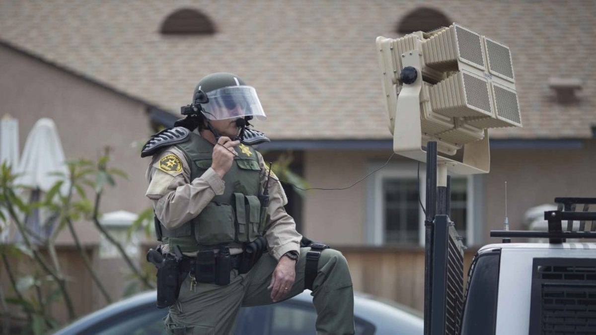 A Los Angeles County Sheriffs deputy in riot gear stands ready to use a sound cannon, or Long Range Acoustic Device (LRAD), against protesters near a campaign rally by presumptive GOP presidential candidate Donald Trump at the Anaheim Convention Center on May 25, 2016.