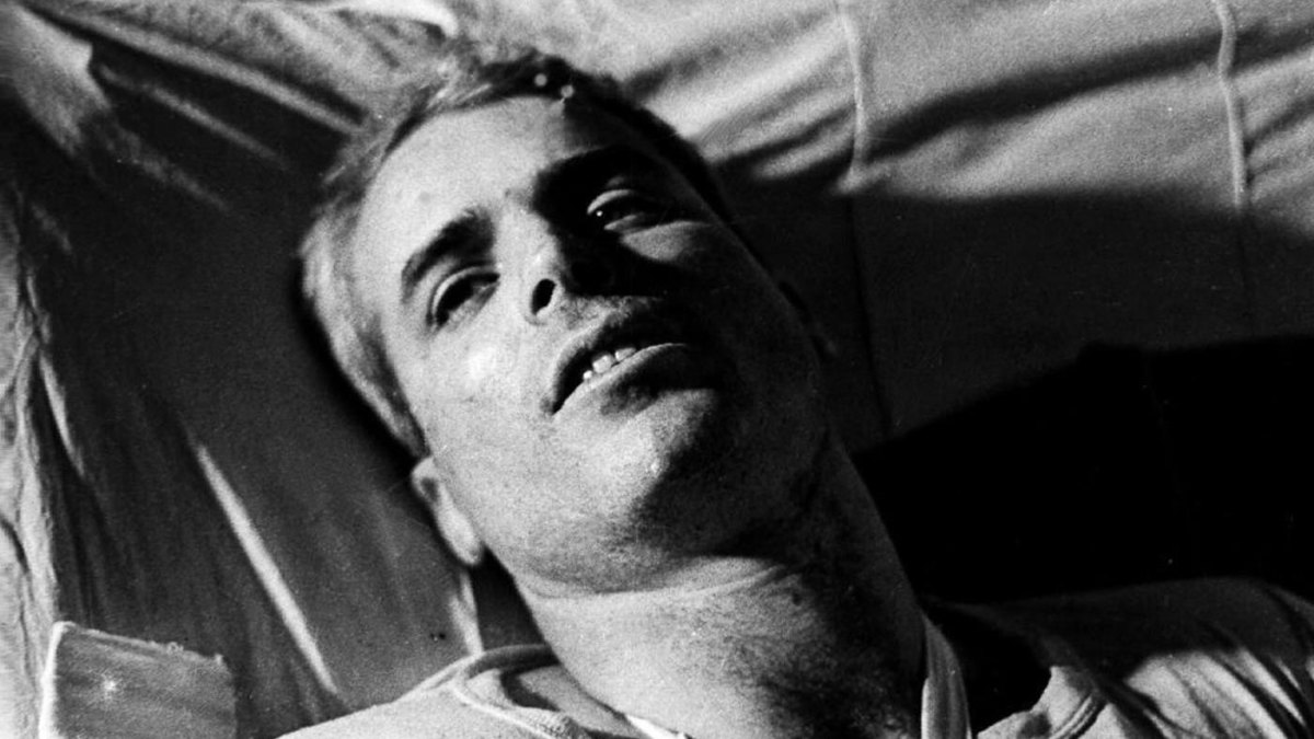 A 1967 photograph showing U.S. Navy Air Force Major John McCain in a Hanoi hospital as he was being given medical care for his injuries after his Navy warplane was downed by the Northern Vietnamese army and was captured.