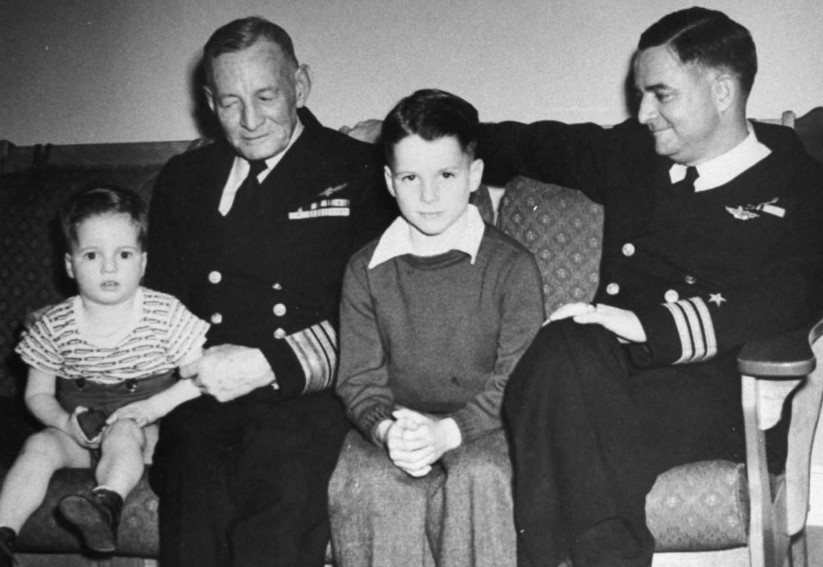 Future US Senator John S. McCain III (center) as a young boy, with his grandfather Vice Admiral John S. McCain Sr. (left), and father Commander John S. McCain Jr., circa 1940s.