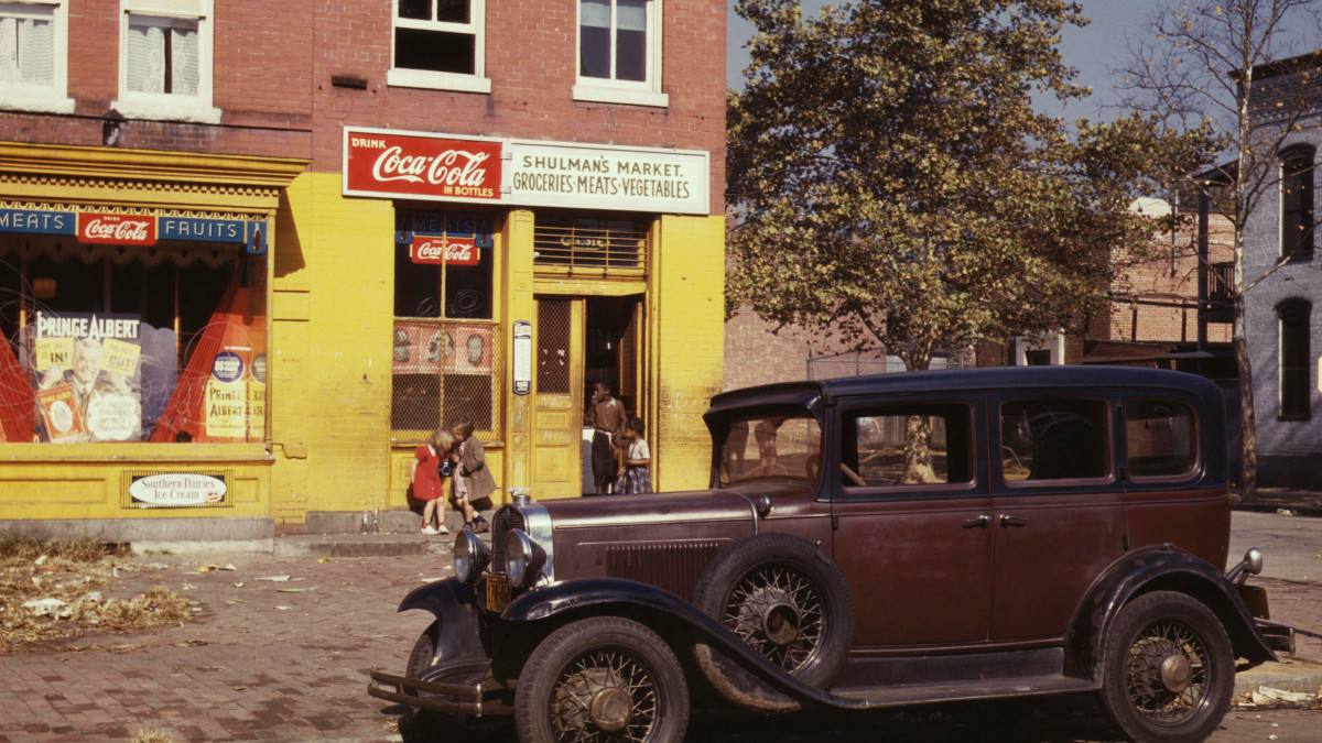 1931 Chevrolet parked in front of a market, Washington, D.C., 1941.