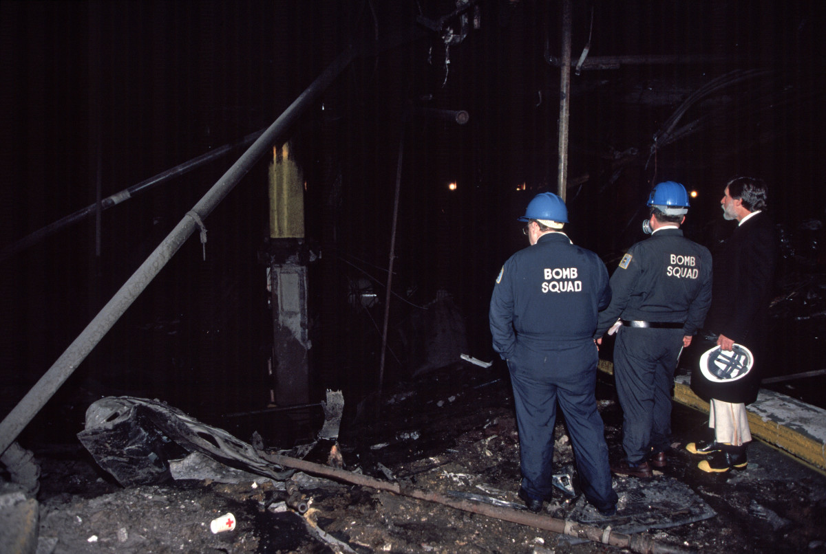 New York Police Department Bomb Squad inspects the crater caused a terrorist's truck bomb at the World Trade Center on February 26, 1993.