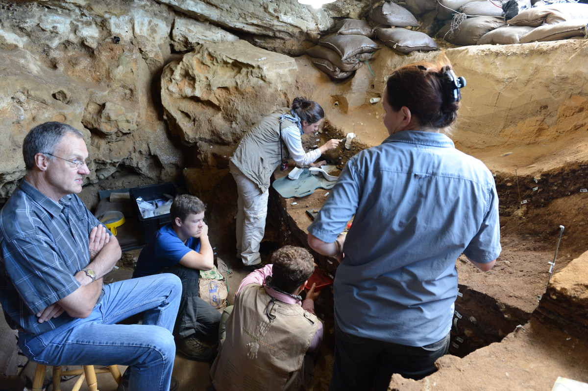 Professor Chris Henshilwood and his team working behind the scenes in the cave where the drawing was found.