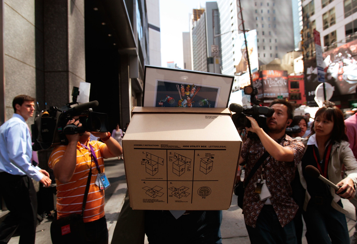 An employee of Lehman Brothers Holdings Inc. carrying a box out of the company's headquarters after it filed for bankruptcy.