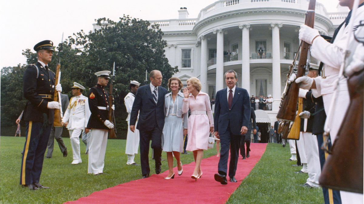 The Fords with the Nixons, as they depart the White House in disgrace.