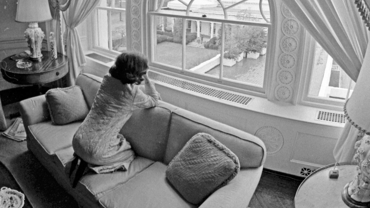 Betty looking out the window of the White House family quarters