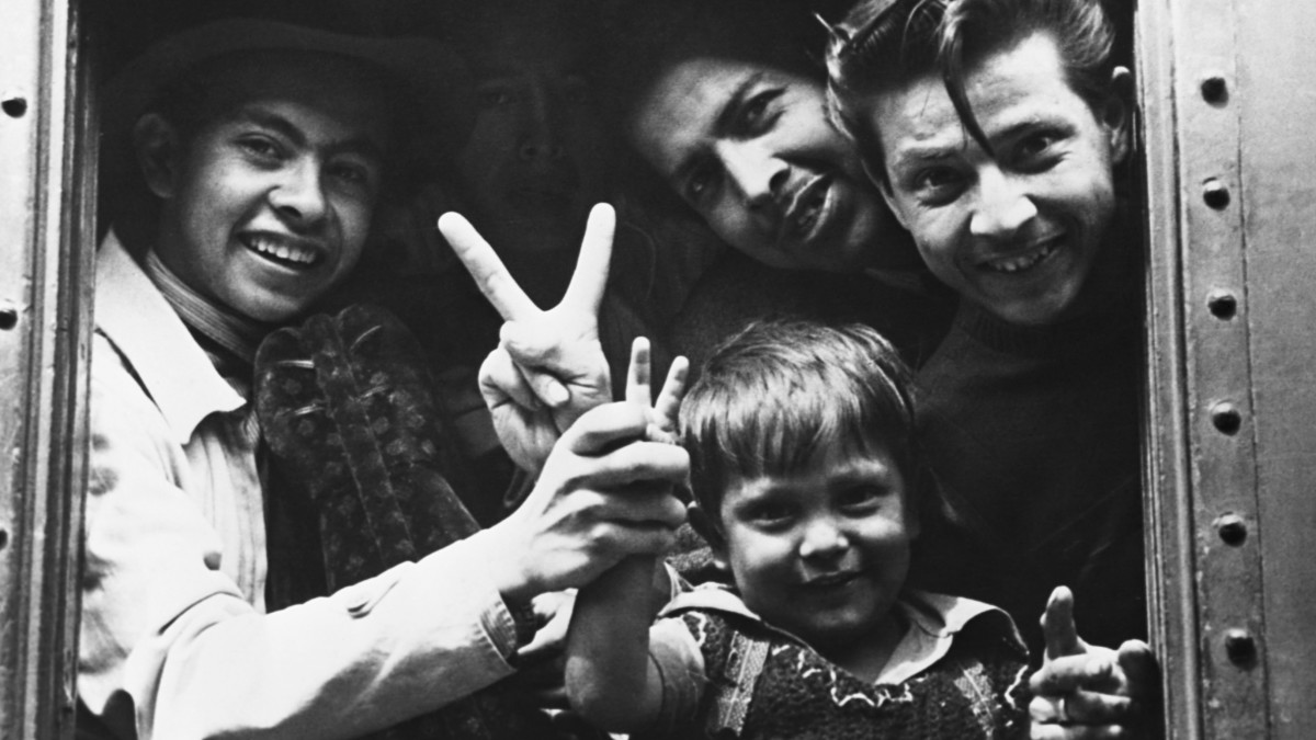 A Mexican family leaving to cross the border during World War II to help wartime labor shortages, 1944.
