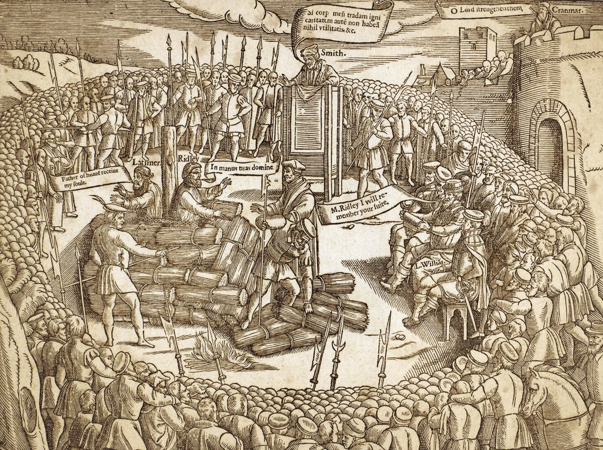"The 1555 execution of Bishop Nicholas Ridley and Father Hugh Latimer, as depicted in the ""Book of Martyrs"" by John Foxe."