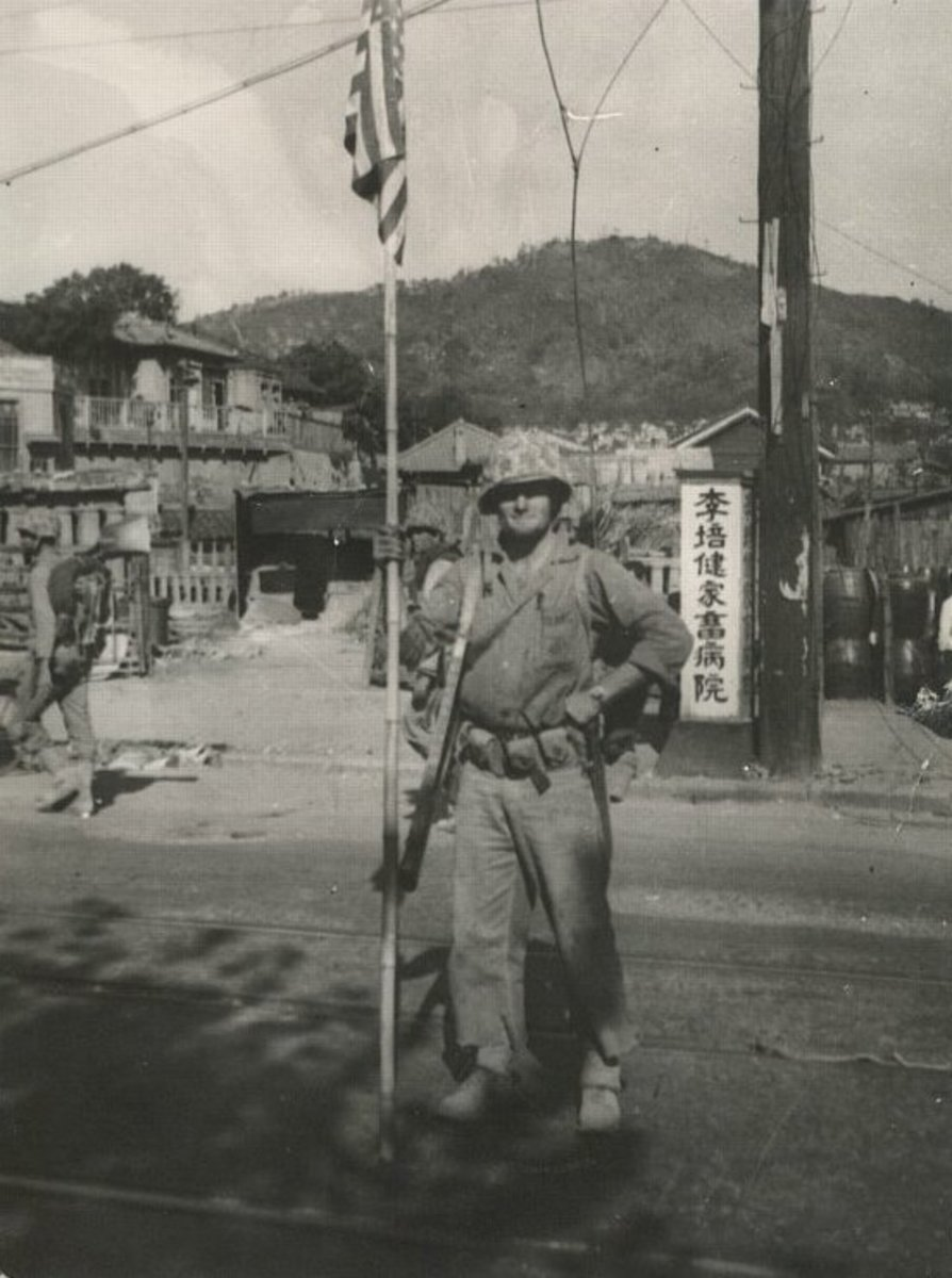 Jean White posing for a picture during the capture of Uijongbu following the landing at Inchon on the march north, some time between September 28th and October 3rd, 1950.