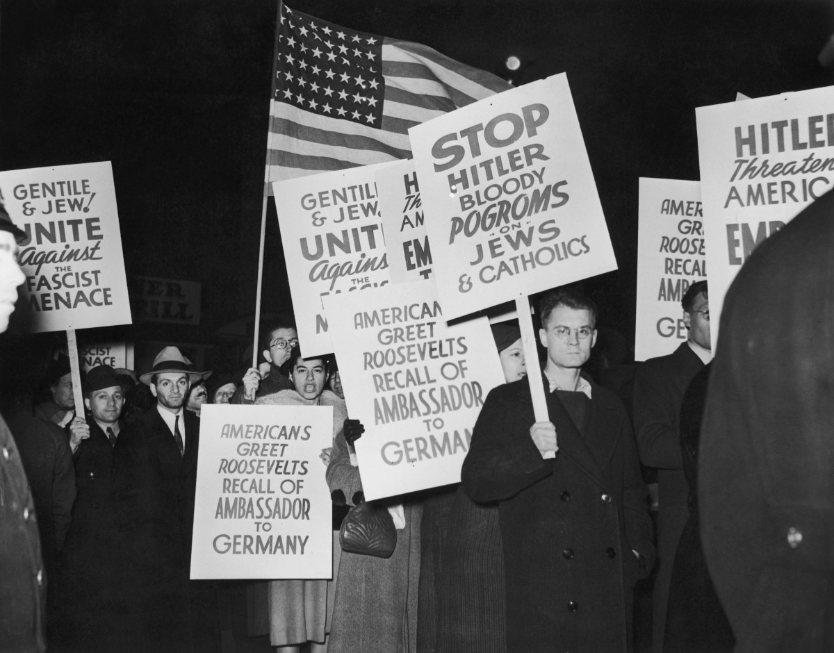 A demonstration near the German ocean liner SS Bremen in New York, after Hugh Wilson, the American ambassador to Germany was recalled in the wake of Kristallnacht, 1938.
