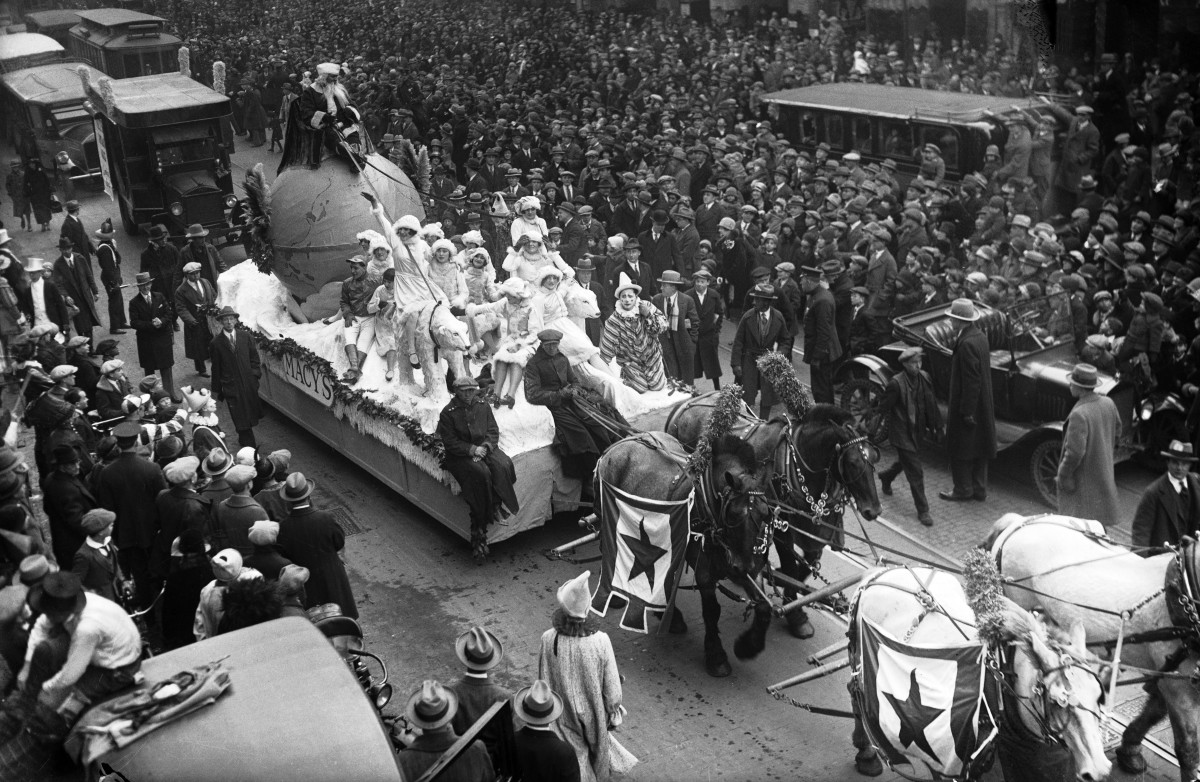 Santa Claus on a parade float pulled by a team of horses down Broadway during the annual Macy's Thanksgiving Day Parade in New York City, 1925.