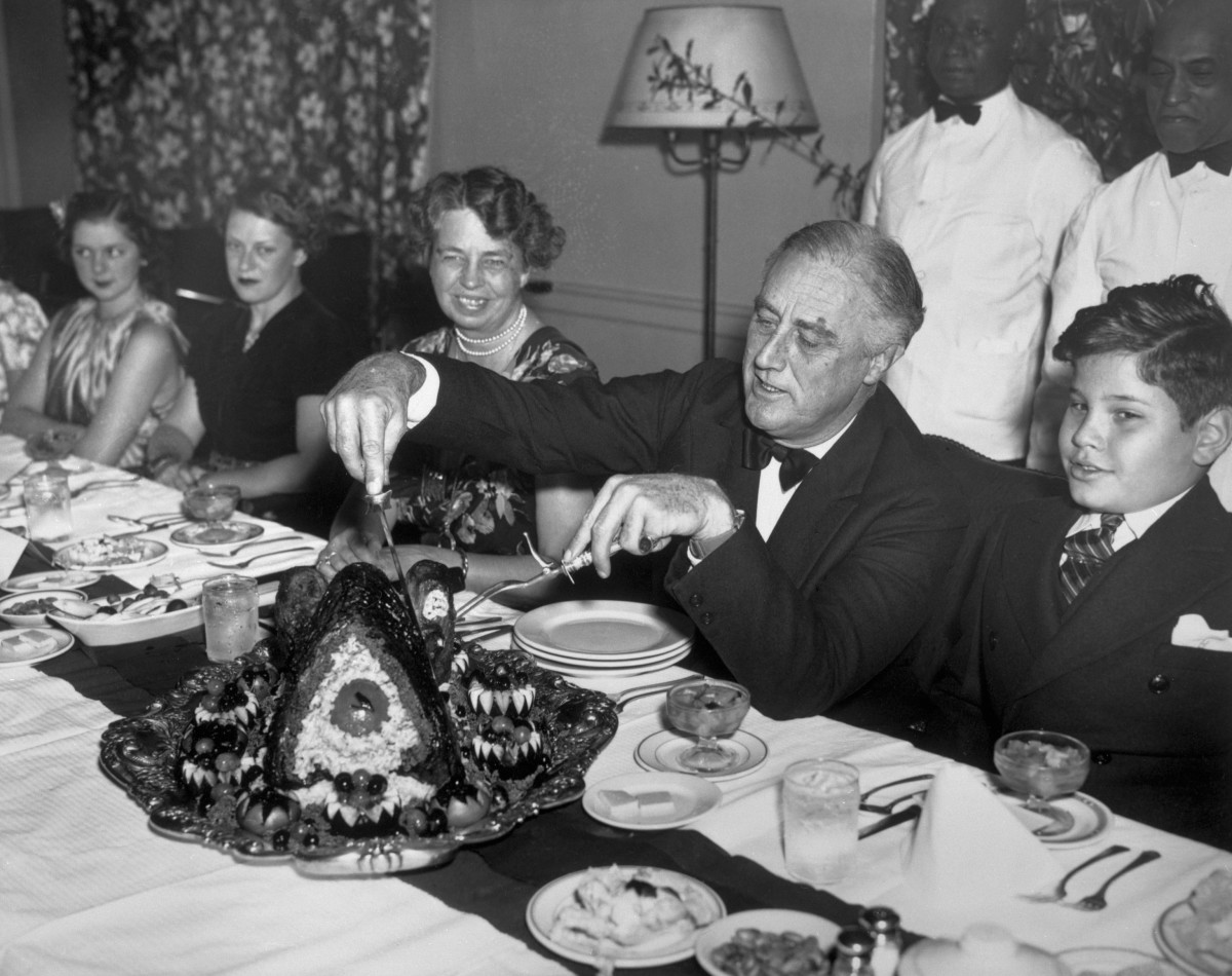 President Franklin D. Roosevelt carving the turkey at Thanksgiving dinner in 1938.