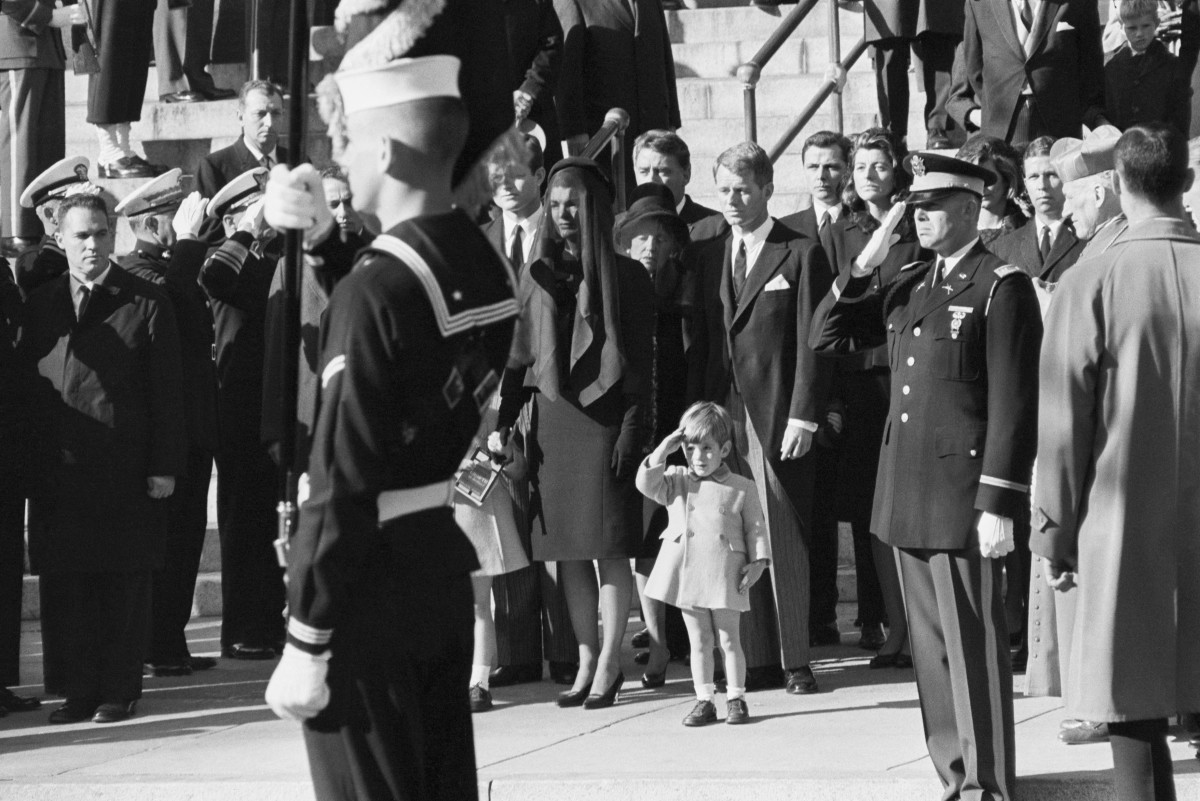 John F. Kennedy Jr. saluting as the casket of his father, the late President John F. Kennedy, is carried from St. Matthew's Cathedral in Washington, D.C.