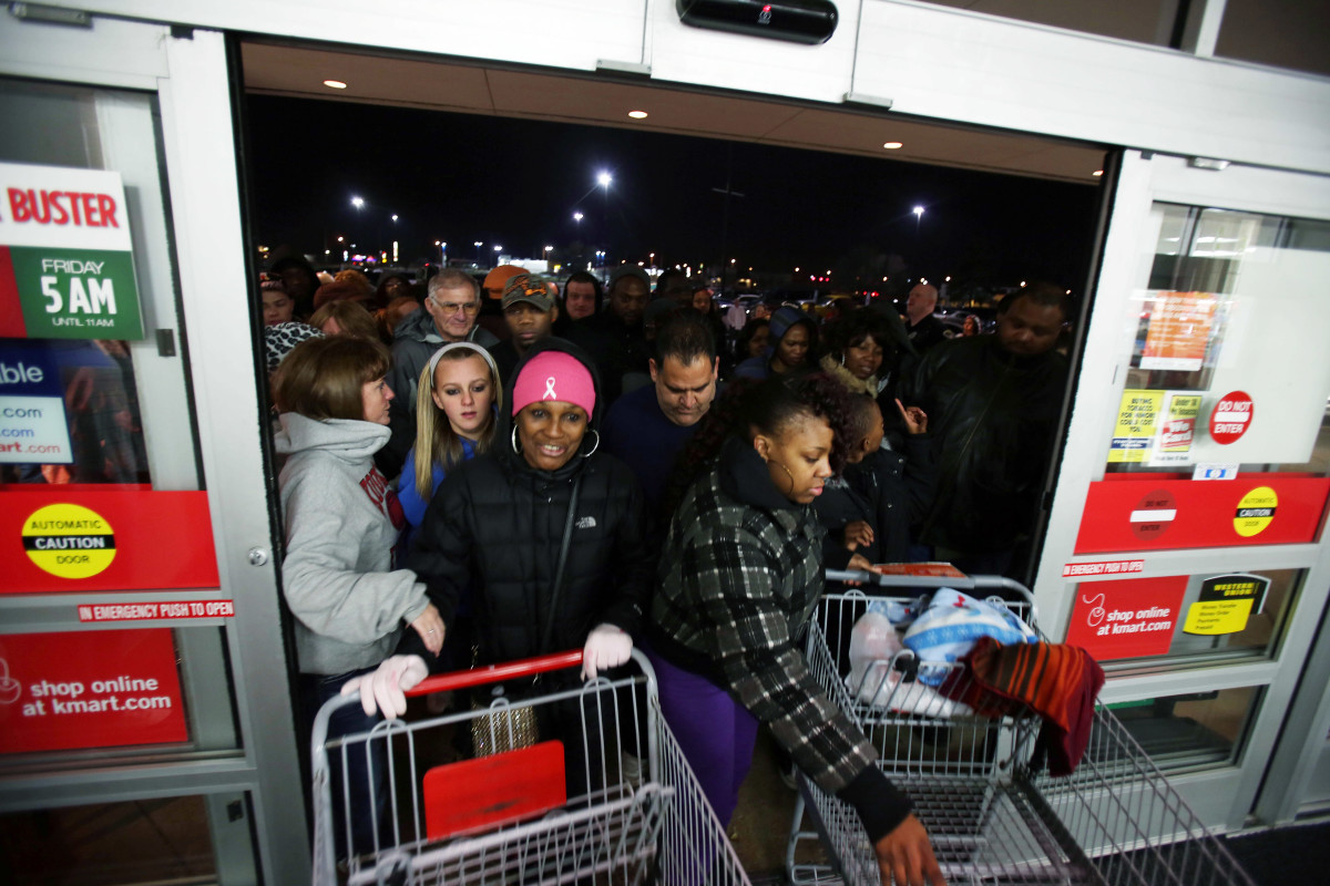 Shoppers entering Kmart as it opens on Thanksgiving night in Griffith, Indiana, 2012.