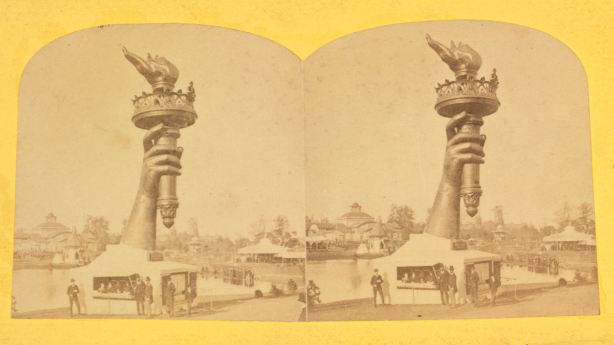 The colossal hand and torch of Bartholdi's Statue of Liberty at the Philadelphia Centennial exhibition, 1876.